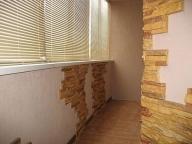 Использование в дизайне балконов декоративного камня и штукатурки сегодня очень популятрно