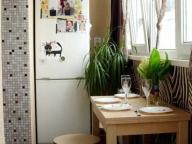 Небольшую кухню можно разместить на балконе