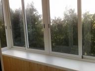 Остекление балкона расширенного по подоконнику