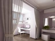 В спальне можно разместить рабочую зону на присоединенном балконе